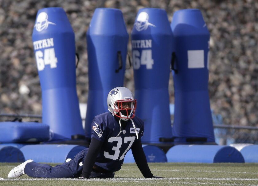 New England Patriots cornerback Alfonzo Dennard (37) stretches during a stretching session before practice begins at the NFL football team's facility in Foxborough, Mass., Wednesday, Dec. 4, 2013. The Patriots will face the Cleveland Browns on Sunday in Foxborough. (AP Photo/Stephan Savoia)