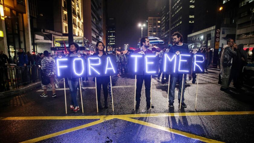 Demonstrators protest the government of Brazilian President Michel Temer in Sao Paulo on Thursday. T