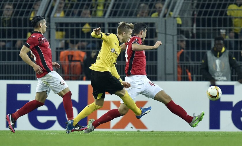 Dortmund's Marco Reus scores the opening goal from the distance during the Europa League group C soccer match between Borussia Dortmund and Qabala FC in Dortmund, Germany, Thursday, Nov. 5, 2015. (AP Photo/Martin Meissner)