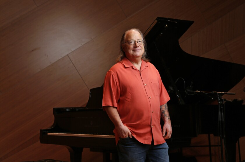 Although he is a veteran pianist who composes on keyboards, Joe Garrison's concerts with his genre-blurring ensemble, Night People, find him conducting the group, rather than performing with it.