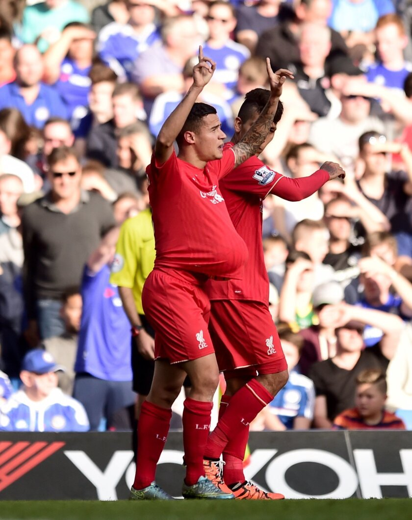 Liverpool's Philippe Coutinho, foreground, celebrates scoring his side's first goal of the game  during the English Premier League soccer match between Chelsea and Liverpool at Stamford Bridge stadium in London, Saturday, Oct. 31, 2015. (Adam Davy/PA via AP)  UNITED KINGDOM OUT