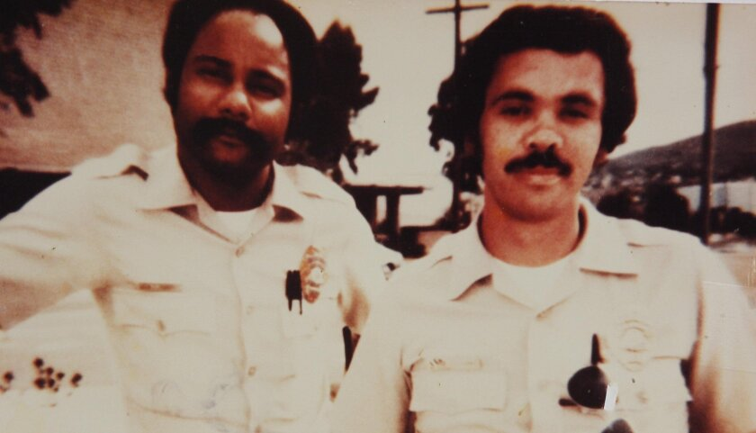 San Diego police Officer Archie Buggs, left, and then-partner Jesse Navarro. Buggs was gunned down in 1979.