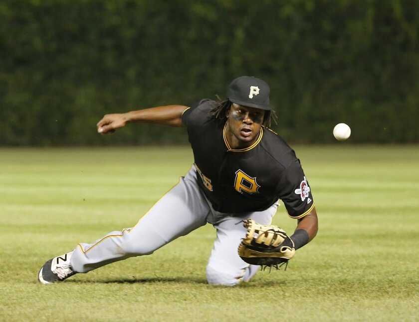 Pittsburgh Pirates first baseman Josh Bell is unable to catch a broken-bat pop-up double by Chicago Cubs' Kris Bryant during the third inning of a baseball game Tuesday, Aug. 30, 2016, in Chicago. (AP Photo/Charles Rex Arbogast)
