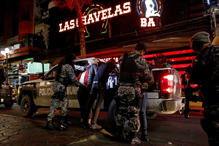 Tijuana police frisk people for drugs in Tijuana. Stop-and-frisk raids are among Tijuana's primary tactics to reduce the city's soaring violence.