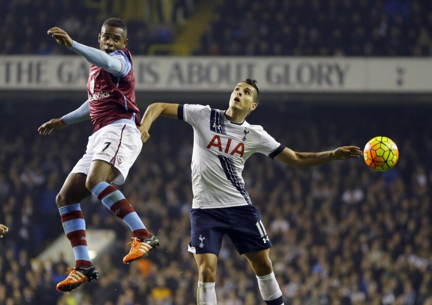 Tottenham's Erik Lamela, right, in action with Aston Villa's Leandro Bacuna during the English Premier League soccer match between Tottenham Hotspur and Aston Villa at White Hart Lane stadium in London, Monday, Nov. 2, 2015. (AP Photo/Kirsty Wigglesworth)