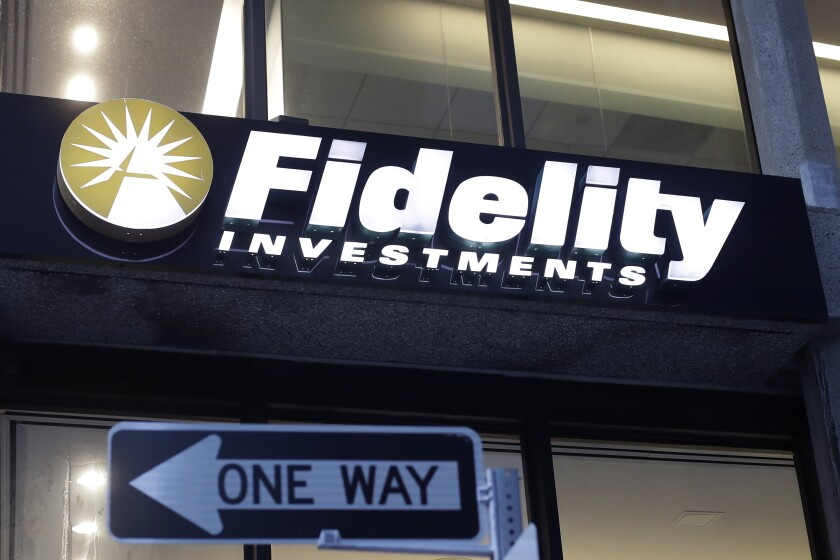 FILE - In this Oct. 14, 2019 file photo a Fidelity Investments logo is attached to a building, in Boston. Fidelity is launching a new type of account for teenagers to save, spend and invest their money. The account is for 13- to 17-year-olds, and it will allow them to deposit cash, have a debit card and trade stocks and funds. (AP Photo/Steven Senne, File)
