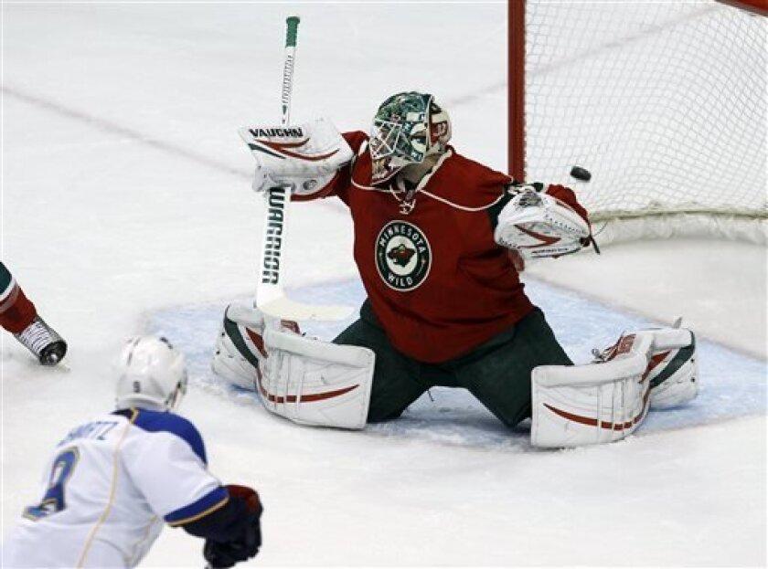 St. Louis Blues center Jaden Schwartz (9) scores on Minnesota Wild goalie Niklas Backstrom (32) of Finland during the first period of an NHL hockey game in St. Paul, Minn., Monday, April 1, 2013. (AP Photo/Ann Heisenfelt)