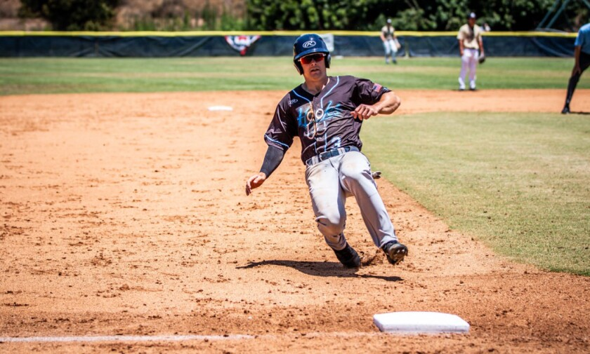 Mike Jarvis slides into third base during the San Diego League all-star game.