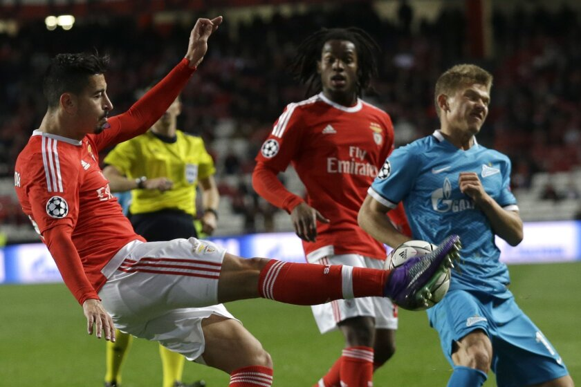 Benfica's Andre Almeida fights for the ball against Zenit's Oleg Shatov during a Champions League Round of 16 first leg soccer match between Benfica and Zenit at Benfica's Luz stadium in Lisbon, Portugal, Tuesday, Feb. 16, 2016. (AP Photo/Armando Franca)