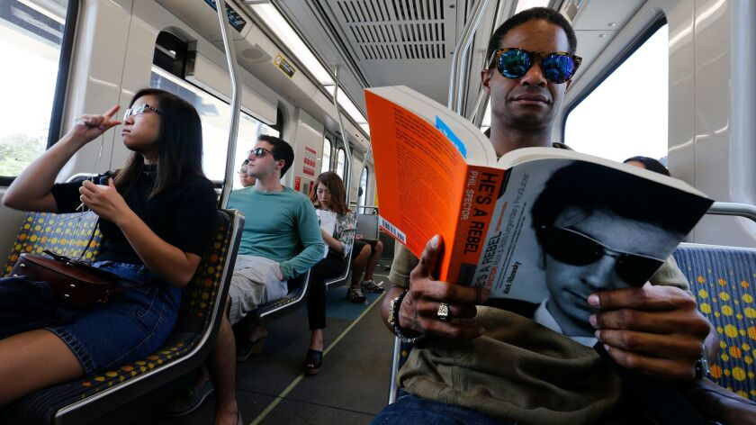 SANTA MONICA, CA-AUGUST 26, 2016: Raymond Parker of North Hollywood, right, rides the westbound Metr