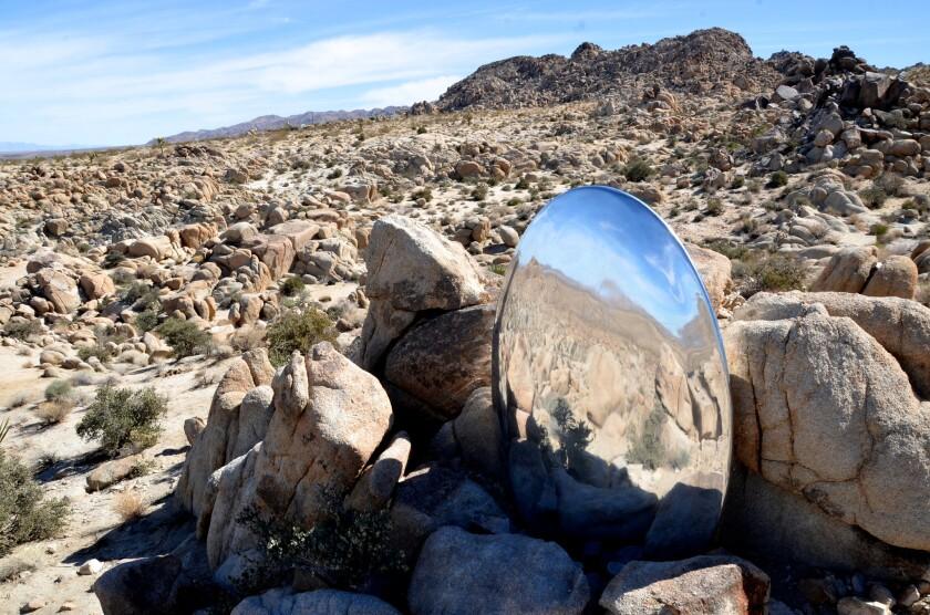 "Sarah Vanderlip's aluminum sculpture ""untitled"" is nestled among the rocks outside Joshua Tree National Park."
