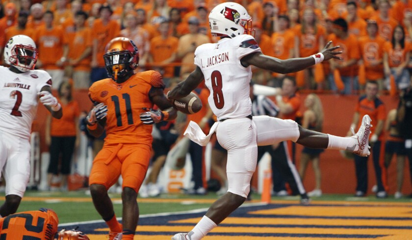 Louisville's Lamar Jackson high-steps into the end zone for a touchdown in the first quarter against Syracuse on Sept. 9.