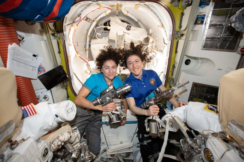 NASA astronauts Jessica Meir, left, and Christina Koch inside the Quest airlock preparing for their first spacewalk together.