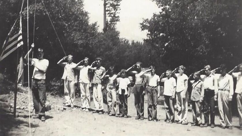 A Troop 1 flag ceremony is held during a camping trip in 1939 at Crystal Lake in the Angeles Nationa