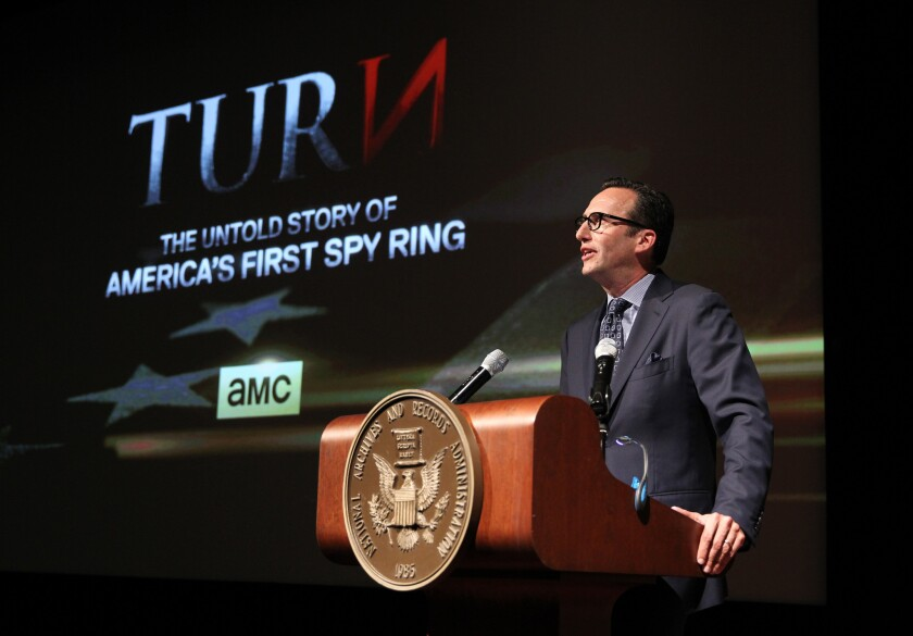 """AMC President Charlie Collier makes a few remarks at the premiere of AMC's new series """"Turn"""" at the National Archives on Monday in Washington, D.C."""