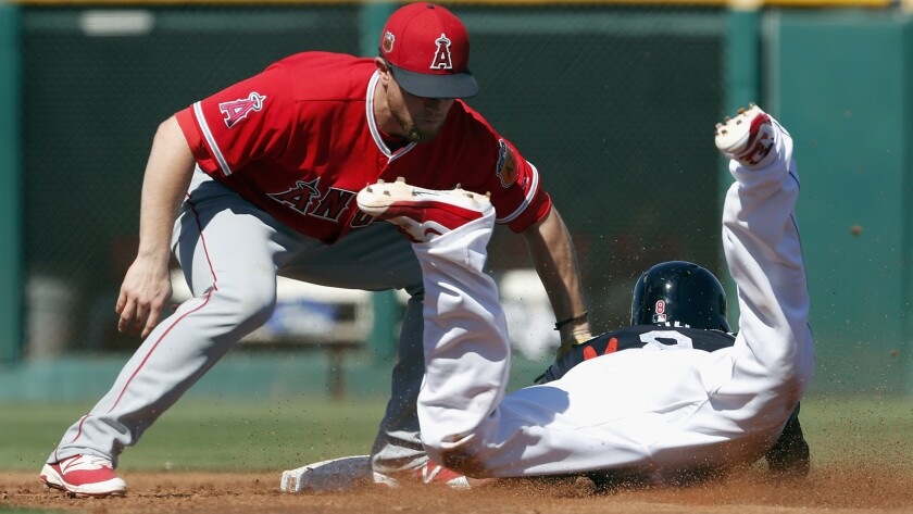 Angels shortstop Nolan Fontana tags out Indians center fielder Lonnie Chisenhall on a steal attempt during the third inning Thursday.