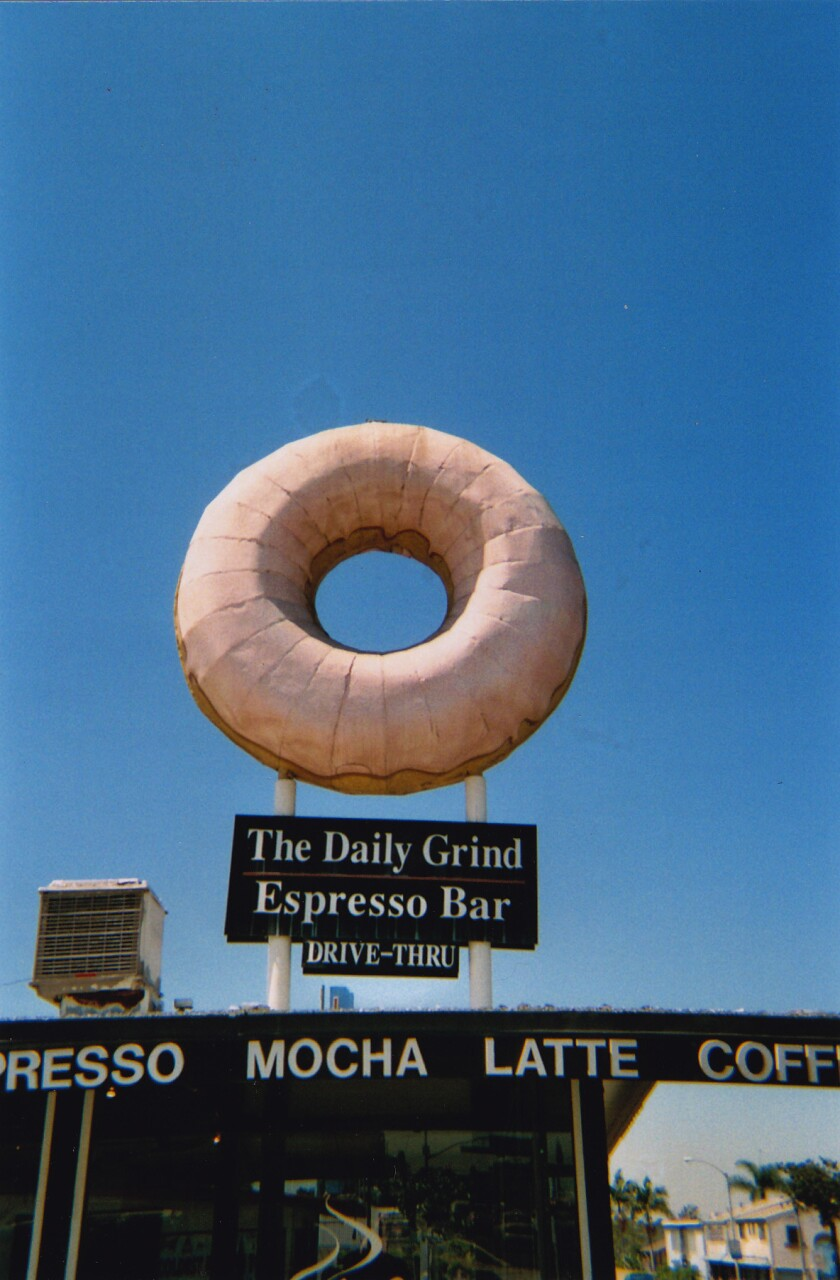 Fans of a giant doughnut structure atop a cafe sign in Long Beach have succeeded in convincing new owner Dunkin' Donuts to keep the local landmark.