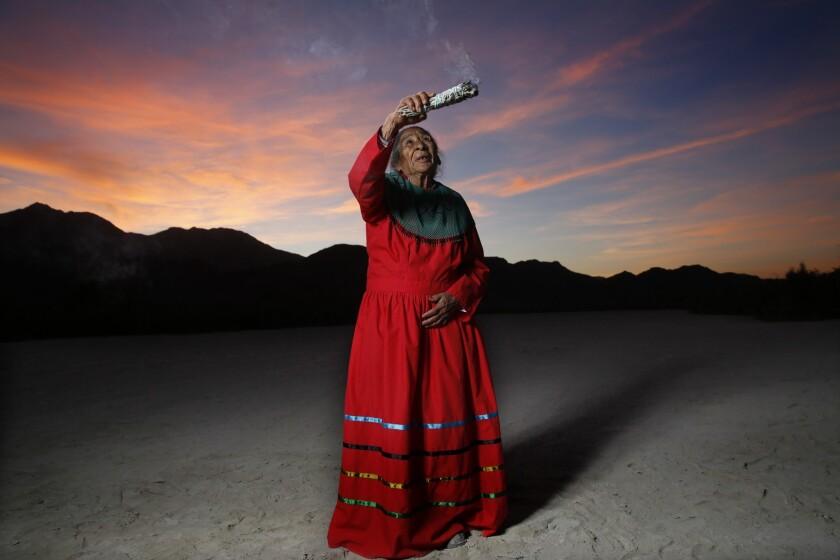Inocencia Gonzalez Saiz waves burning sage over a dry marsh