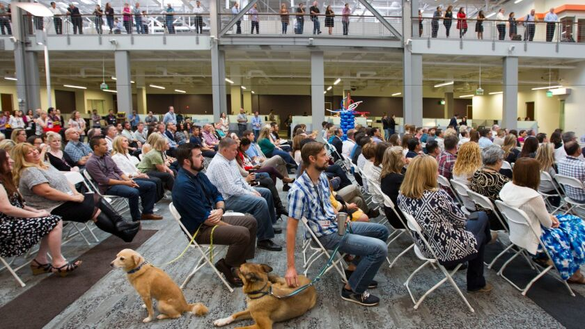 Petco employees, some with their pets, attend a grand opening gathering in October 2015 at the newly opened 300,000 square-foot corporate headquarters in Rancho Bernardo.