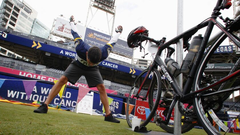 Brandon Waterfield from Oceanside stretches out before the start of last year's Padres Pedal the Cause.