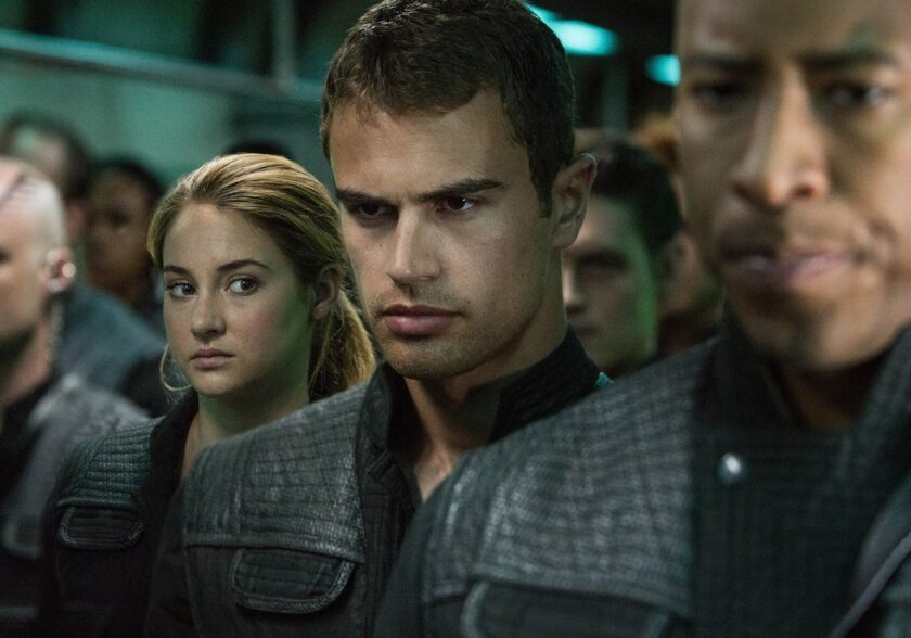 """This image released by Summit Entertainment shows Shailene Woodley, left, and Theo James in a scene from """"Divergent."""" (AP Photo/Summit Entertainment, Jaap Buitendijk)"""
