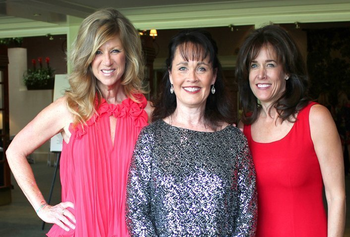 """Event chair Kristi Pieper, Foundation president Beth Penny and fundraising chair Claire Andrews attend The Foundation of La Jolla High School's """"Burning Red"""" gala, March 14, 2015 at La Jolla Country Club."""