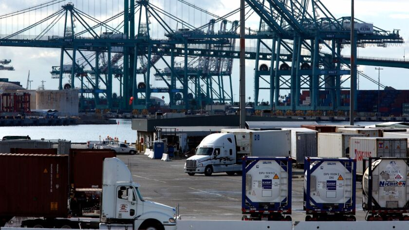 Trucks pull out at the Port of Los Angeles on November 2.