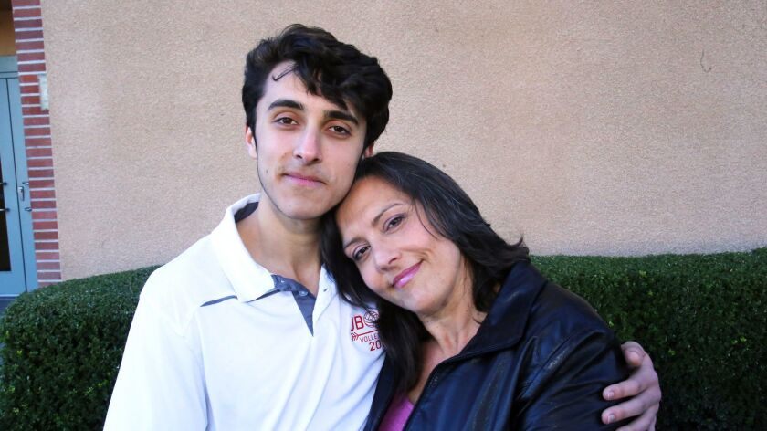 Louis Zekowski a student at John Burroughs High School, and his mother Jules Ford pose for a picture