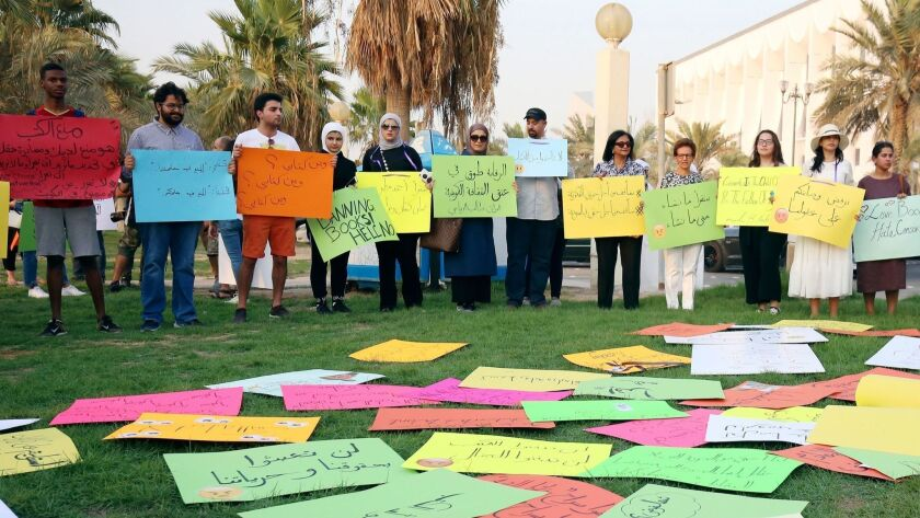 Kuwaitis gather outside the National Assembly building in Kuwait City on Sept. 15 in protest of the government's censorship on publications that resulted in the ban of many books from entering the country.