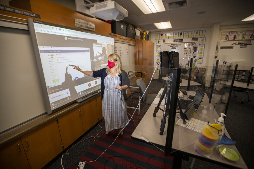 A second-grade teacher at Sycamore Magnet Academy in Tustin conducts a remote lesson on Sept. 23, 2020.