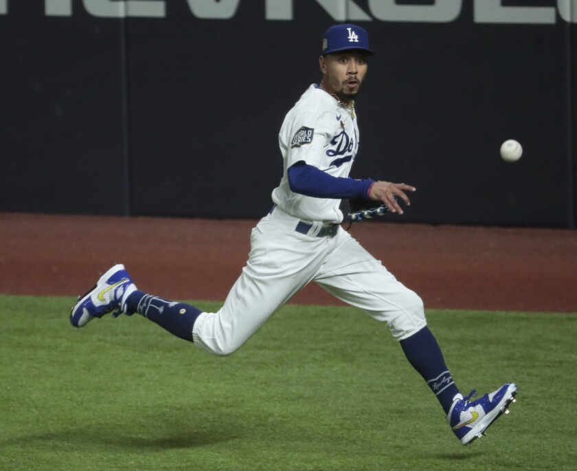 Dodgers right fielder Mookie Betts chases a single by Tampa Bay Rays designated hitter Austin Meadows.