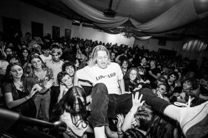 Chordoroy frontman Taylor Sandoval surfing the crowd during the band's June set at Queen Bee's in North Park.