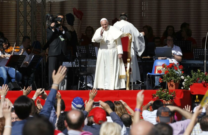 Pope Francis waves to faithful as he arrives for a meeting at Rome's Olympic stadium, Sunday, June 1, 2014. (AP Photo/Riccardo De Luca)