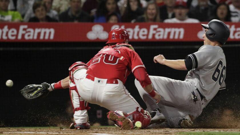 ANAHEIM, CA, MONDAY, APRIL 22, 2019 - Yankees catcher Kyle Higashioka slides safely into home as Ang