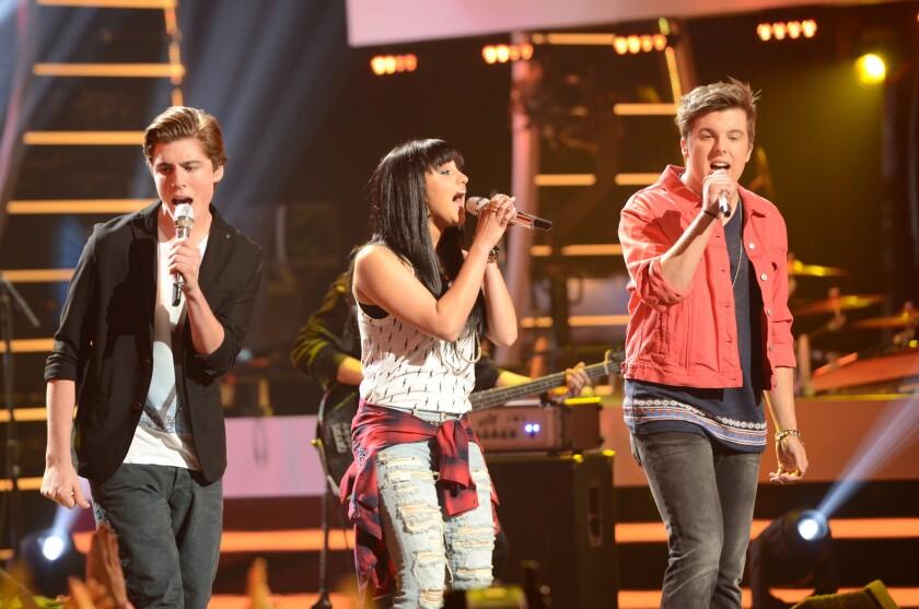 """Sam Woolf, left, Jena Irene and Alex Preston perform on """"American Idol"""" on April 30, 2014."""