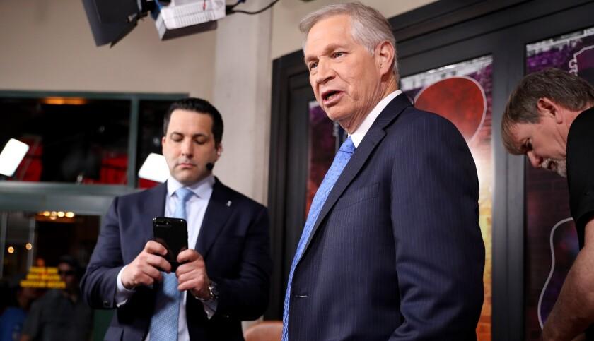"Chris Mortensen, right, and ESPN colleague Adam Schefter prepare for an ""NFL Live"" show during the 2019 draft."