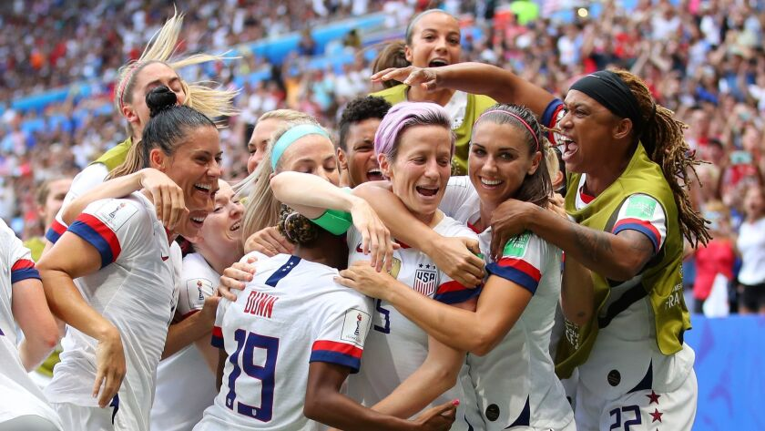 Megan Rapinoe celebrates with her U.S. teammates Sunday following their 2-0 victory over the Netherlands in the Women's World Cup final in Lyon, France.