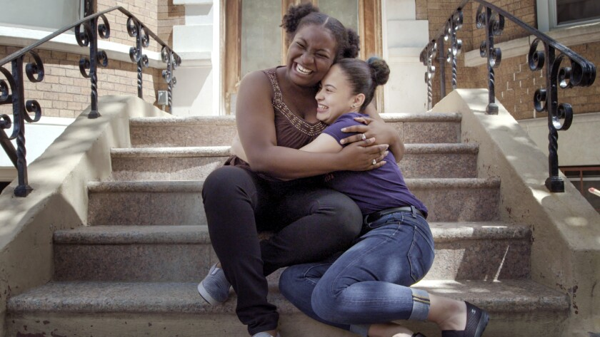 """DeWitt Clinton High School students Danielle and Estefany embrace in the documentary """"The Bronx, USA."""""""