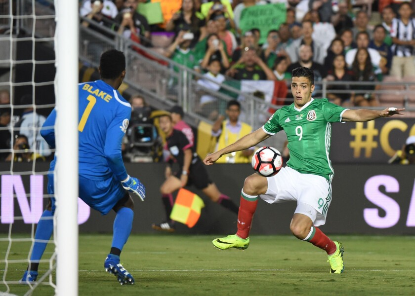 Mexico's Raul Jimenez (9) tries to score past Jamaica's Andre Blake during a Copa America Centenario match at the Rose Bowl.