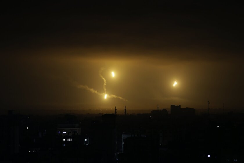 """Flares light up the sky over Gaza City, Friday Aug. 1, 2014. Israeli Prime Minister Benjamin Netanyahu said Thursday that Israel will destroy Hamas' tunnel network in the Gaza Strip designed for deadly attacks inside Israel, """"with or without a cease-fire."""" Israel expanded what started July 8 as an"""