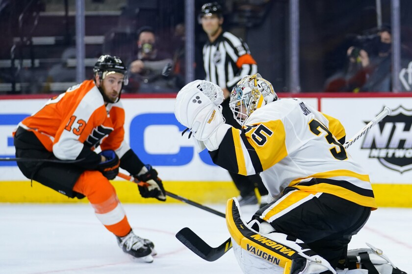 Pittsburgh Penguins' Tristan Jarry, right, blocks a shot as Philadelphia Flyers' Kevin Hayes looks on during the third period of an NHL hockey game, Tuesday, May 4, 2021, in Philadelphia. (AP Photo/Matt Slocum)