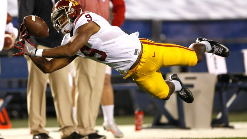 Trojans receiver JuJu Smith-Schuster can't haul in a pass during the first quarter of the Holiday Bowl on Wednesday night in San Diego.