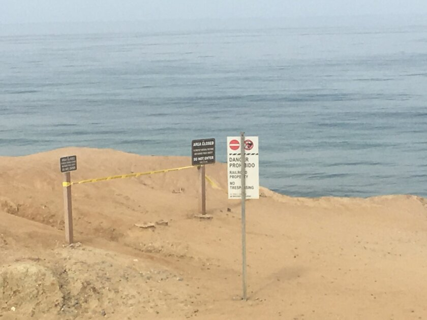 Police are investigating a cliff collapse near 10th Street across from Ocean Avenue in Del Mar.  Photo by Kristina Houck