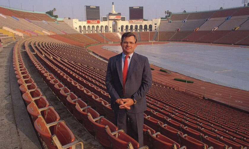 Mike McGee standing in the Los Angeles Memorial Coliseum during his tenure as USC athletic director.