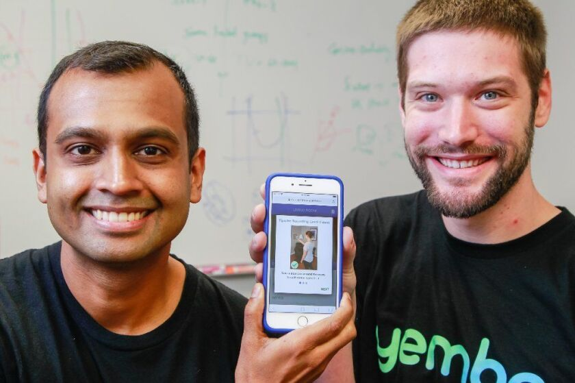 Yembo co-founders Siddhartha Mohan (left) and Zach Rattner pose at their office in 2018.