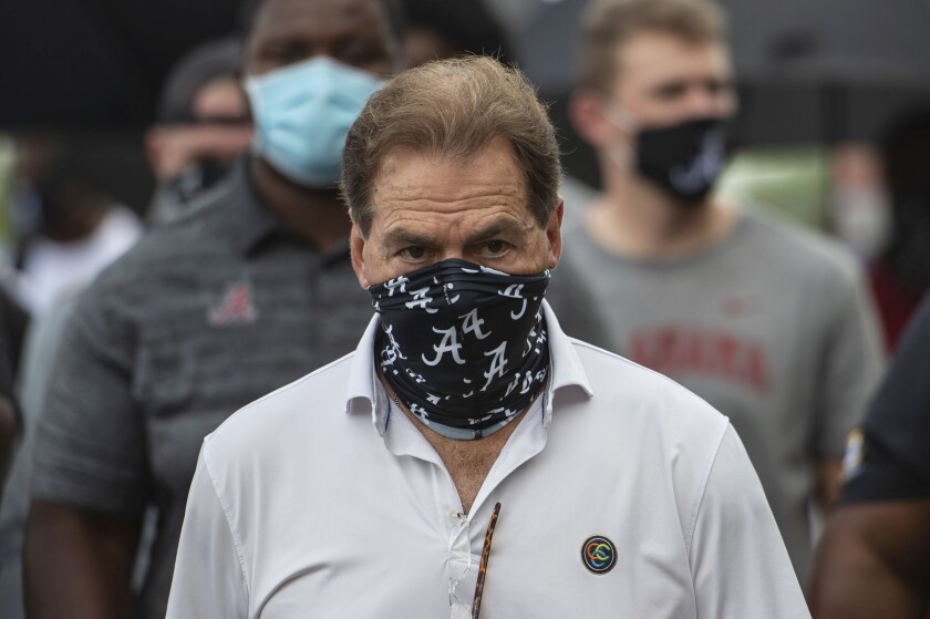Alabama head football coach Nick Saban leads his team as it marches on campus in support of the Black Lives Matter movement