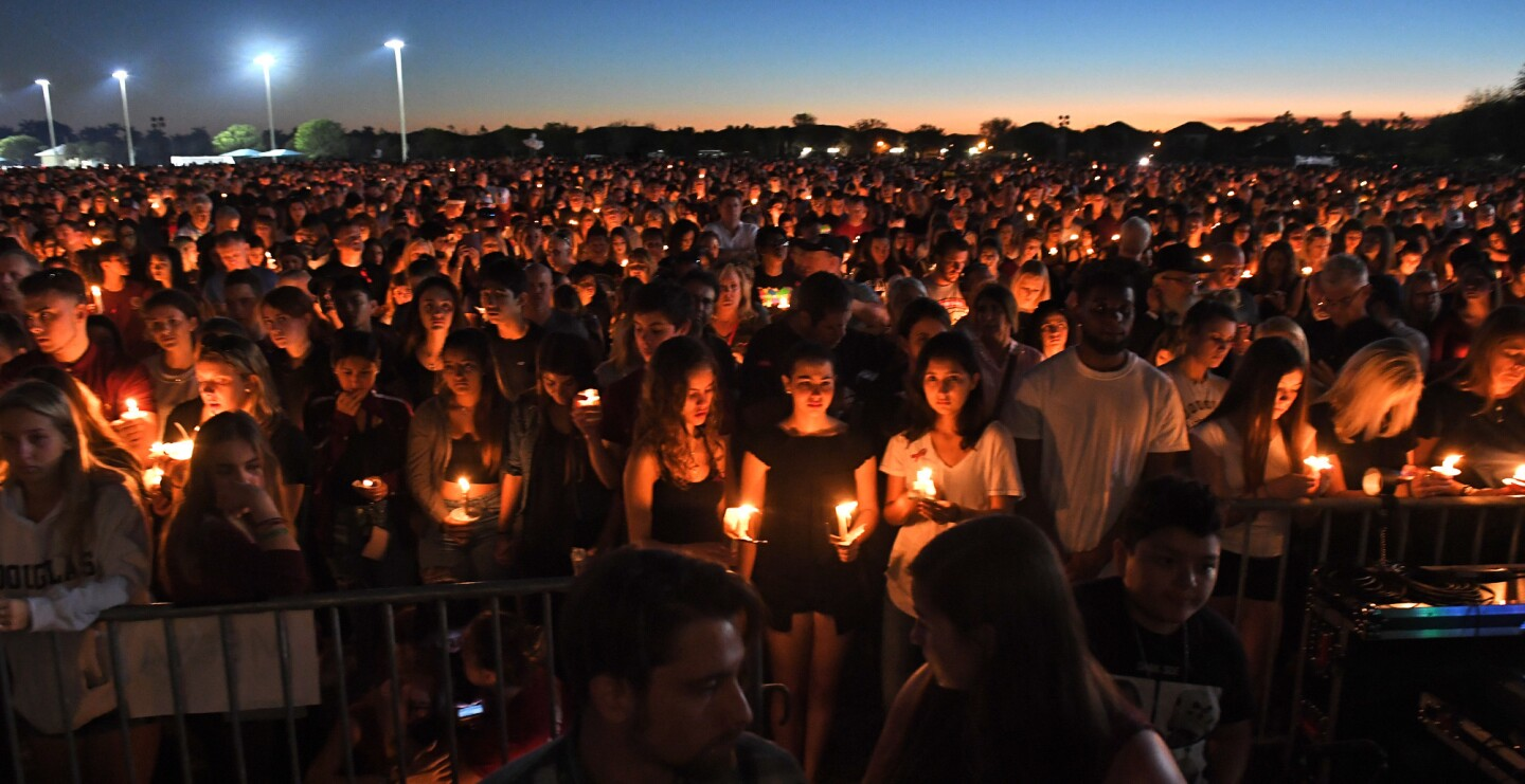 Mourners gather at a vigil that was held for the victims of the mass shooting at Marjory Stoneman Douglas High School at the Udine Amphitheatre located inside Pines Trail Park. Parkland, FL. 2/15/18. Staff Photographer Jim Rassol.