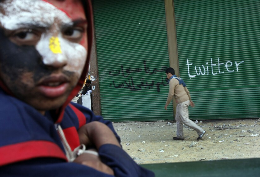 A protester at Cairo's Tahrir Square takes part in demonstrations in 2011, when Egyptians used social media to help overthrow autocratic President Hosni Mubarak.