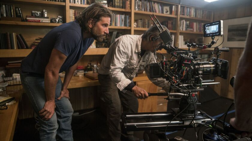 """Director/co-writer/producer Bradley Cooper, left, and camera operator Scott Sakamoto on the set of """"A Star is Born."""""""