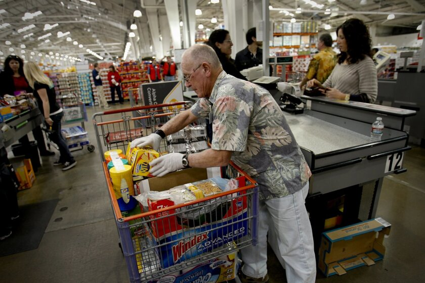 Eddie Eaton, a cashier's assistant, and other sales staff can easily keep track of Costco items by number rather than pricetag, a concept that predated the scannable bar codes.